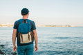 A Tourist With A Backpack On The Coast. Travel, Tourism, Recreation. Royalty Free Stock Images - 97252879