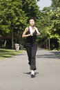 Asian Girl Running In A Park Stock Photography - 9730712