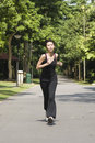 Asian Girl Running In A Park Royalty Free Stock Photography - 9730747