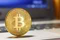 Golden Bitcoin On The Laptop Touchpad Closeup. Cryptocurrency Virtual Money Royalty Free Stock Photo - 97304905
