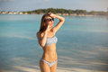 Spa Wellness Beach Beauty Woman In Bikini Swimwear Relaxing And Sun Bathing Near Blue Lagoon. Beautiful Peaceful Young Royalty Free Stock Image - 97343146