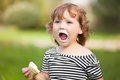 Funny Toddler Girl Eating Ice Cream Royalty Free Stock Image - 97349966