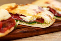 Sliced Pizza Calzone Whith Ham On Wooden Board Royalty Free Stock Image - 97359326