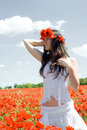 Girl In Poppy Field Royalty Free Stock Photos - 9747578
