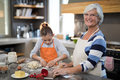 Granddaughter Kneading Dough Royalty Free Stock Photography - 97400557
