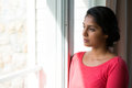Thoughtful Young Woman Looking Through Window Stock Photography - 97401162