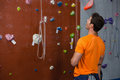 Rear View Of Young Man Looking Up While Standing By Climbing Wall Stock Images - 97409634