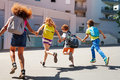 Kids With Backpacks Run To School Royalty Free Stock Photography - 97428197