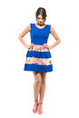 Emotional Young Woman In Blue Short Dress Looking Down With Akimbo Arms Pose. Royalty Free Stock Images - 97444589