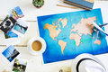 Traveller Desk With Folded Paper Map Of World And Photos Stock Photography - 97450262