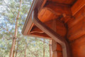 Roof Gutter System On Log House In Forest Royalty Free Stock Photo - 97450675