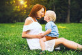 Loving Mother And Her Son On Nature Stock Photos - 97455053