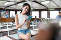 Woman Working On Mobile Phone In Ferry Stock Image - 97464891