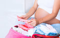 Pregnant Woman Packing Suitcase, Bag For Maternity Hospital Royalty Free Stock Photography - 97488197