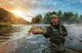 Sport Fisherman Holding Trophy Fish. Outdoor Fishing In River Royalty Free Stock Images - 97555529