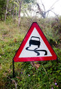 A Red Triangle Driving Sign On The Side Of Road Stock Photos - 97560593
