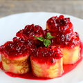 Delicious Crepes Rolls With Red Currant Sauce On A White Plate. Fried Crepes Rolls Recipe. Yummy Easter Breakfast Idea Stock Photo - 97580150