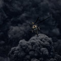 Attack Helicopter Against The Background Of Smoke. Stock Image - 97581151