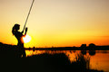 Silhouette Of A Fishing Woman At Dawn Royalty Free Stock Photography - 97600837