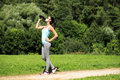 Fitness Woman Drinking Water After Running At Park Stock Photos - 97624463