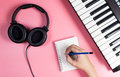 Musician Is Writing On Notebook With Studio Pink Stock Photo - 97658820