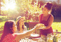 Happy Friends Having Dinner At Summer Garden Party Royalty Free Stock Photos - 97687048
