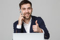 Business Concept - Portrait Handsome Business Man Showing Thump Up And Smiling Confident Face In Front Of His Laptop. White Backgr Royalty Free Stock Images - 97701569