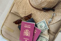 Tourism Travel Concept. Suitcase With Female Hat, Sunglasses, Spanish Passports, Dollars And Padlock Stock Image - 97703581