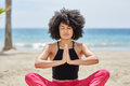 Pretty Afro American Woman Meditating On Beach Royalty Free Stock Photo - 97740465