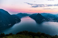 Aerial View Of The Lake Lugano Surrounded By Mountains And Evening City Lugano On During Dramatic Sunset, Switzerland, Alps. Stock Photography - 97748892
