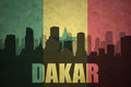 Abstract Silhouette Of The City With Text Dakar At The Vintage Senegalese Flag Royalty Free Stock Photography - 97757897