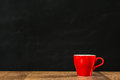 Lonely Red Coffee Cup With Black Wall Background Stock Images - 97774354