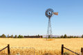 Water Pump Windmill At Wheat Farm In Rural Oregon Royalty Free Stock Photo - 97774985