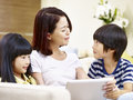 Asian Mother And Children Having Fun At Home Stock Photos - 97785213