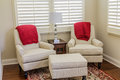 White Chairs With Red Throws Royalty Free Stock Photo - 97788385