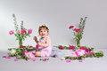 Happy A Small Child Sits With A Flower, Grey Background. Royalty Free Stock Photos - 97797028