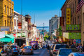 Downtown City Life In A Busy Street Of Chinatown San Francisco. View With Many People, Shops And Cars - Lookout To The Oakland Bay Royalty Free Stock Photo - 97832795