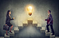 Business People Climbing Stepping Up A Stairway Career Ladder With Idea Light Bulb On A Top Royalty Free Stock Photos - 97843378