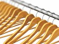 Wooden Coat Hangers On Clothes Rail Royalty Free Stock Images - 97912779