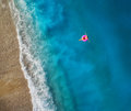 Aerial View Of Young Woman Swimming On The Pink Swim Ring Royalty Free Stock Photo - 97921555