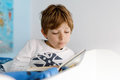 Cute Blond Little Kid Boy In Pajamas Reading Book In His Bedroom Royalty Free Stock Image - 97937146
