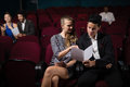 Couple Reading In Theatre Royalty Free Stock Photos - 98001048