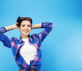 Young Pretty Teenage Modern Hipster Girl Posing Emotional Happy Smiling On Blue Background, Lifestyle People Concept Royalty Free Stock Photos - 98006098