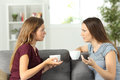 Two Friends Talking Seriously At Home Royalty Free Stock Images - 98020709