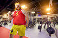 Fat Funny Man Winner Smiles In Sports Clothes In The Gym. Royalty Free Stock Photography - 98021087