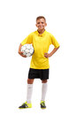 A Full-length Portrait Of A Young Footballer In A Yellow T-shirt Holes In Arms A Ball Isolated On A White Background. Royalty Free Stock Images - 98089919