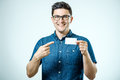 Casual Young Businessman Holding Business Card Royalty Free Stock Image - 98092806