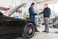 Sports Car In A Workshop Royalty Free Stock Images - 98093389