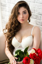 Luxurious Portrait Sensual Woman In White Lingerie With Bouquet Roses In Hands Royalty Free Stock Photos - 98099508