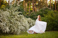 Beautiful Redhead Bride In Fantastic Wedding Dress In Blooming Garden. Royalty Free Stock Photography - 98103097